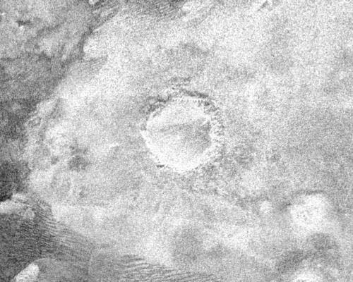 Cassini image of another crater on Titan. Image Credit: NASA/JPL.