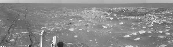 Opportunity, tracks in the sand plus a crater. Image credit NASA/JPL.